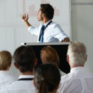 demo-attachment-1442-young-businessman-delivering-presentation-at-PF276WZ@2x